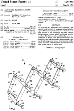 Adjustable rack for hanging articles Patent 4,287,993