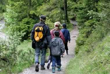 family-walking-in-woods