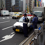 somebody getting a ticket in akihabara by the tokyo police in Akihabara, Tokyo, Japan