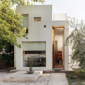 Fachada modera casa besares arquinoma argentina arquitexs for Casa moderna argentina