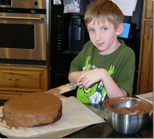 Taylor frosting Bob's birthday cake 2-4-12