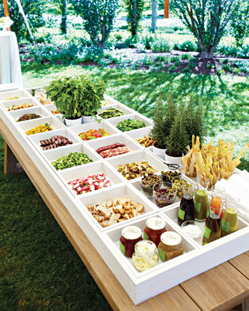 Serving luncheon entrees or crudite in these white boxes make such a chic and modern buffet setting. (marthastewartweddings.com)
