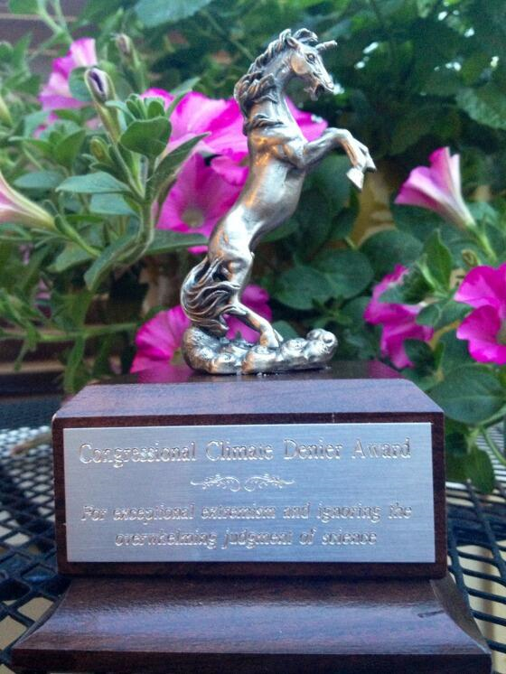 A 'climate denier award' trophy, topped by a unicorn, presented to Republican lawmakers who deny climate science. The accompanying tweet reads 'Climate change deniers in Congress look out—OFA is giving you your #ClimateDenierAward today. pic.twitter.com/ulIe2WMsXT'. Photo: OFA