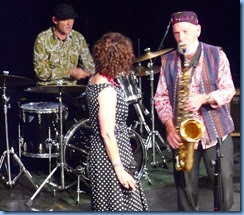 Jim Langabeer on Sax 'flirting' with Maria O'Flaherty. Whilst drummer Jason Orme keeps the temp nice and tight.
