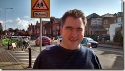 Jamie outside Alfred Sutton school