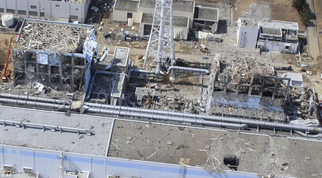 Demolished: An aerial view of the plant taken on March 24 shows Unit 4 and Unit 3 of the Fukushima Dai-ichi nuclear power plant in Okumamachi. A red crane far left shows the valiant efforts of the 'Fukushima 50'. dailymail.co.uk