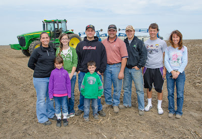 Pictured from left to right: Amanda, Kara (front), Michaela, Troy (front) and Marshall Ramsey with Lindsay, Keaton, Kolton and Shelley Greiner.  Photo courtesy:  Iowa Soybean Association.