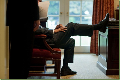 President Barack Obama rests his foot on a desk as he talks with Phil Schiliro,  assistant to the President for legislative affairs, in the Outer Oval Office, Oct.  29, 2009.   (Official White House Photo by Pete Souza)