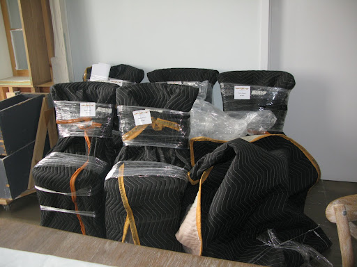These chairs, all wrapped for a safe delivery, were destined for our photo shoot.