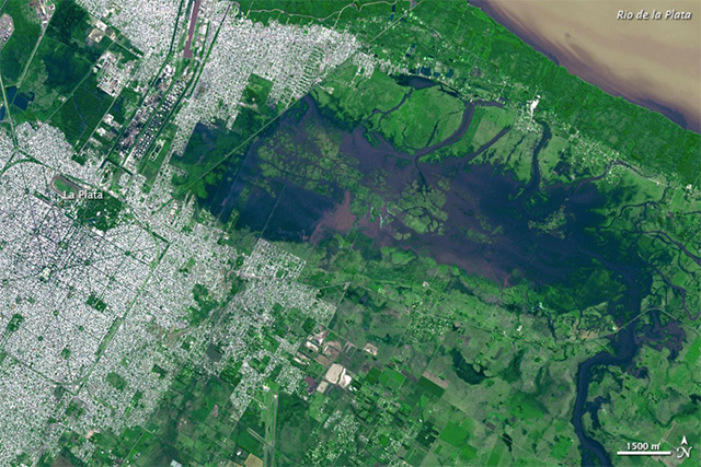 NASA's Terra satellite captured this image on 4 April 2013 of severe flooding in La Plata, which claimed more than 50 lives, and forced thousands from their homes in the Buenos Aires region. Many of the casualties occurred in La Plata, situated about 60 kilometers (40 miles) southeast of Buenos Aires. Roughly 40 centimeters (16 inches) of rain fell on La Plata in a two-hour period 2–3 April 2013. Photo: NASA / GSFC / METI / ERSDAC / JAROS, and U.S. / Japan ASTER Science Team