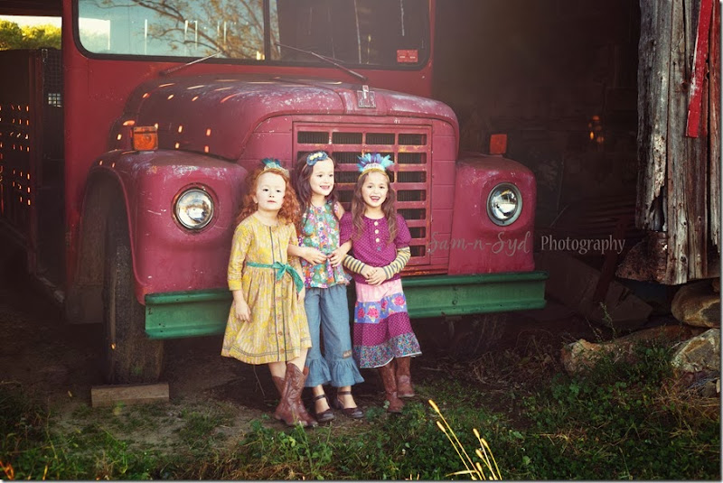 Triplets in front of truck watermark