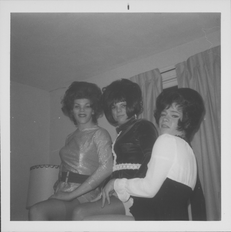 Three drag queens pose for the camera. Circa 1971-1974