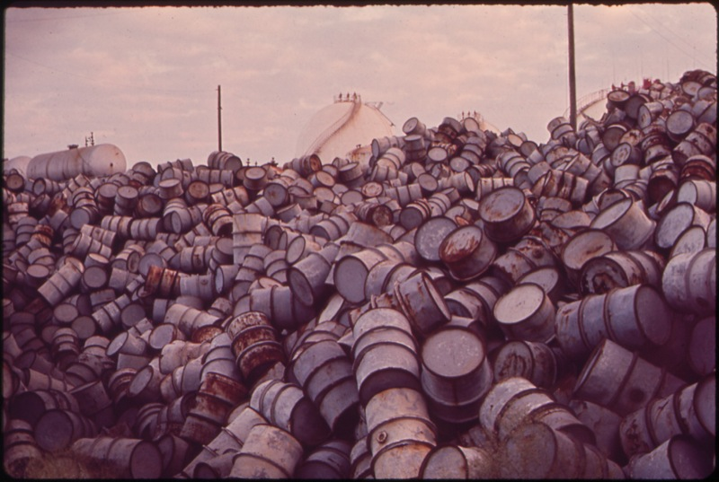 CC Photo Google Image Search.  Source is upload.wikimedia.org  Subject is A Mountain of Damaged Oil Drums Near the Exxon Refinery.jpg