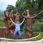 Hubby posing with Kublai statues praising the skies in Agong House area at Kapatagan