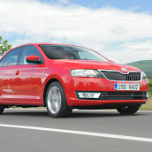 2013-Skoda-Rapid-Sedan-Red-Color-10.jpg
