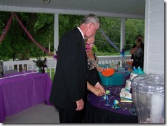 Dee and John June 15, 2013 045 cutting cake