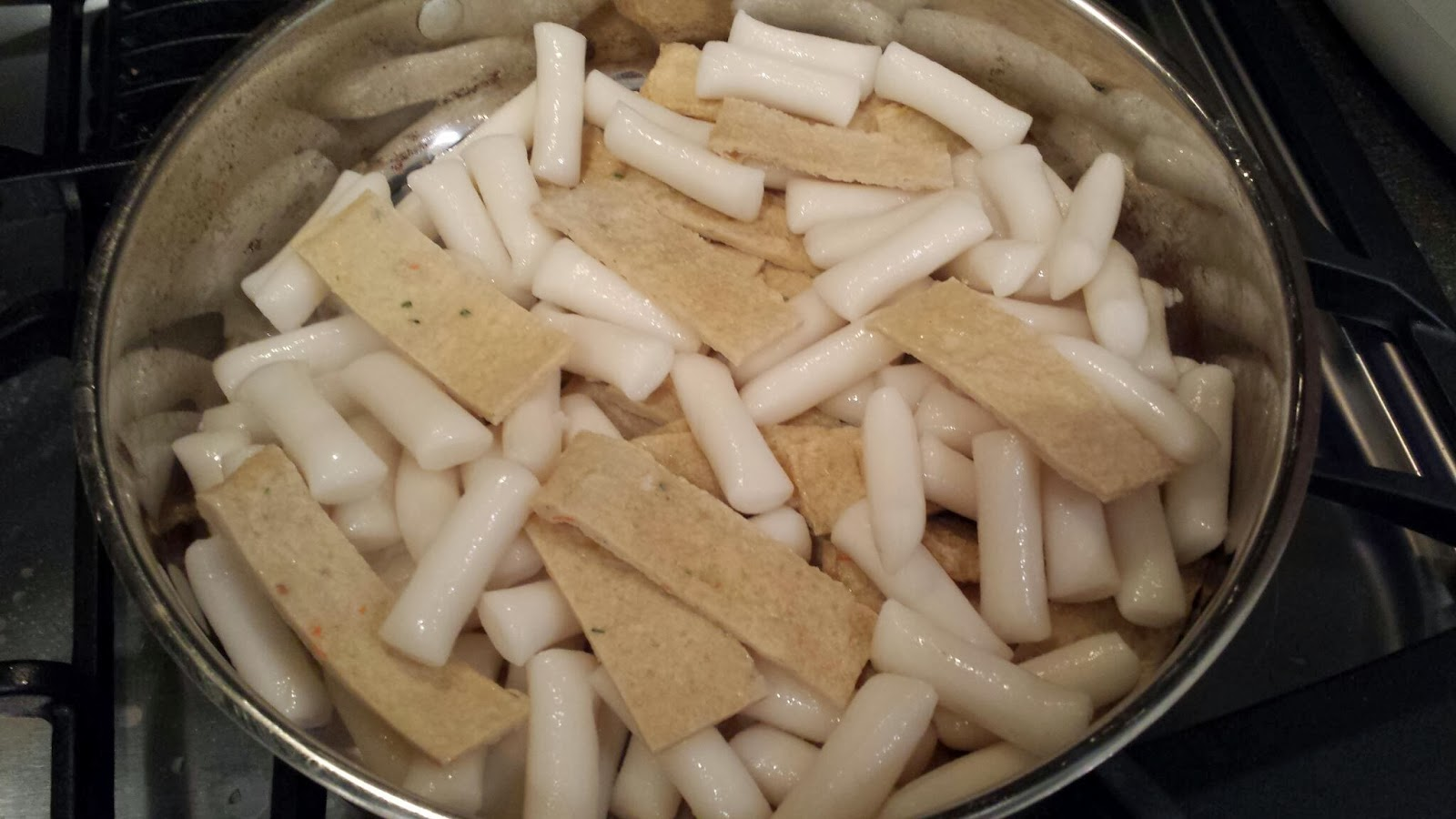 Drain Soaked Rice Cakes In A Large Saute Pan, Place Rice Cakes And Sliced  Fish Cakes