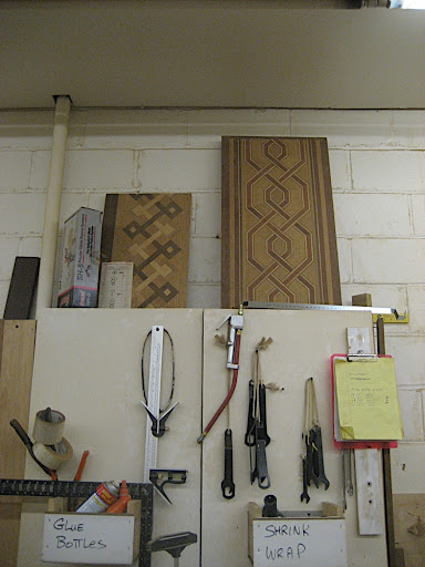 A collection of tools. Check out the inlays on top of the cabinet.