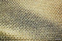 Tkanina meblowa z metalicznym efektem. Złota.