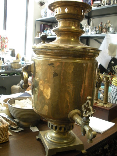 This is a Russian samovar. It is traditionally used to heat and serve tea, but I think it looks great even when it's not being used.