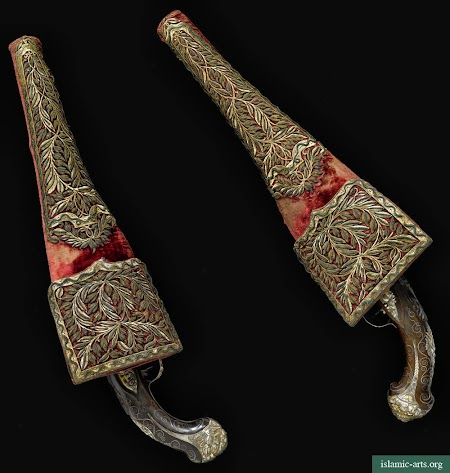 A PAIR OF OTTOMAN SILVER GILT AND WIRE-INLAID PISTOLS WITH METAL THREAD-EMBROIDERED SADDLE HOLSTERS, TURKEY