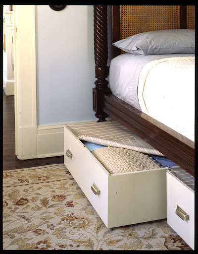 You can also build custom sized boxes and attach casters, drawer pulls and some fabric using a snap kit, to create underbed drawers with dust covers.