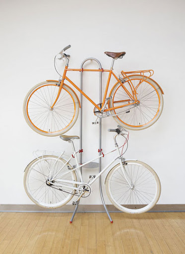 I love the loop at the top of this bike shelf. (Michelangelo bike rack, apartmenttherapy.com)