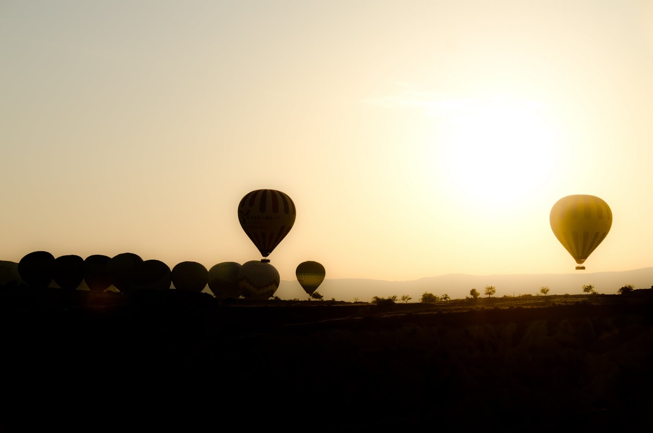 Hot air balloons at sunrise in Cappadocia