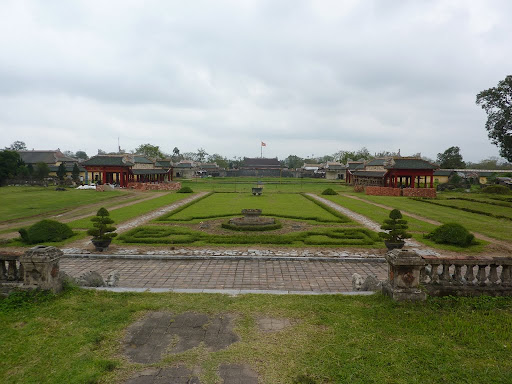 Looking back at the now empty courtyards of Hue citadel, once teeming with over two hundred buildings.