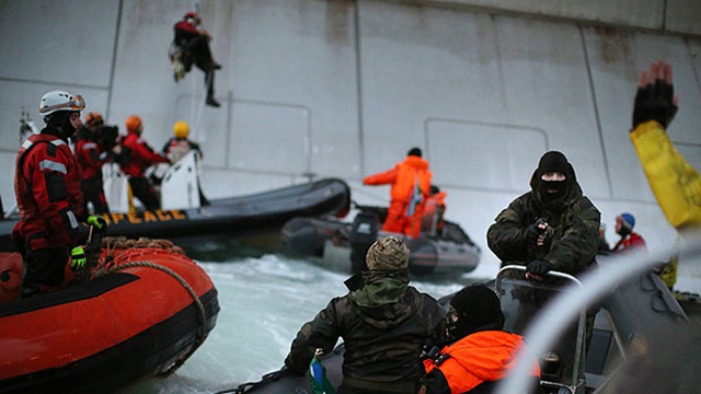 Russian special forces arrest Greenpeace activists protesting against Arctic oil drilling at a platform owned by the state-controlled energy company Gazprom on 26 September 2013. Photo: Greenpeace