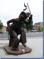 2621 Minnesota Bemidji - Niiemii (meaning He dances) pow wow dancer metal sculpture in park near Paul Bunyan statue