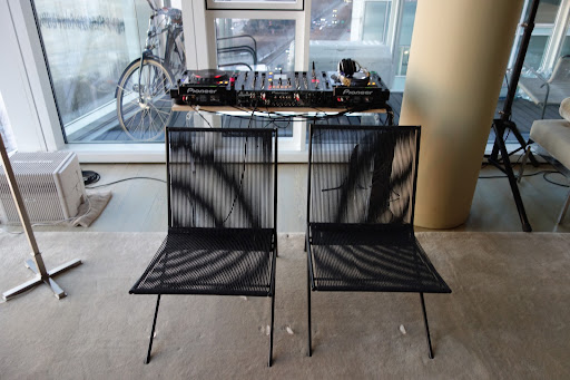 I set-up a DJ booth in the corner of the living room so there would be plenty of great music. I just had to move the chairs in a bit and all was fine. Notice the ice cubes I put on the floor where the chairs had left indentations. They are the quickest way to remove them.