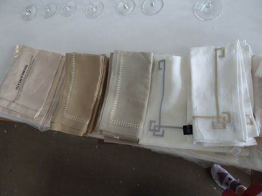 An array of Kim Seybert napkins, all of which had metallic thread detailing.
