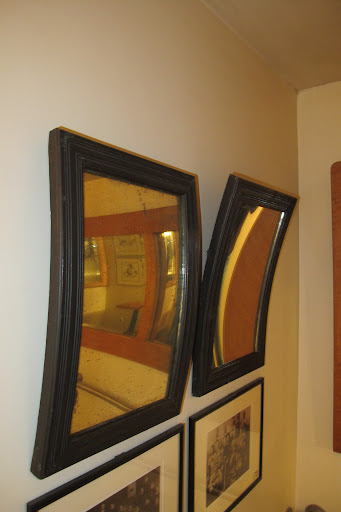 Look at these convex and concave mirrors I found in the shop.