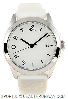 "AGNES B. SPORT B. rubber wrist watches features watch dials with classic ""b. logo"" and ""SPORT"" on light stainless steel watchcases soft rubber watchstraps silver watchcase white watch dial"