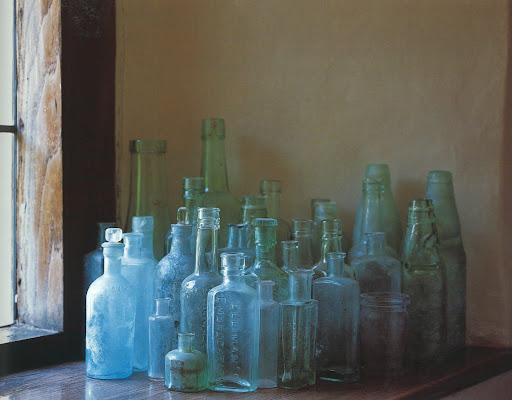 From a Tudor mansion house, a collection of bottles; remnants from the estate's past.