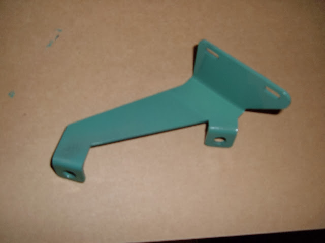 1964 only dual quad transmission kick down bracket, nice repro 125.00