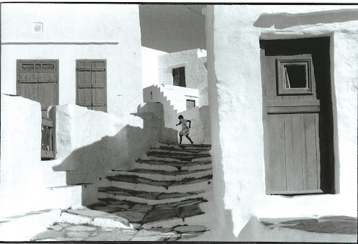 Sifnos, Greece, 1961. The bleached white buildings and contrasting shadows along with the simple movement of a girl makes this image. It reminds me of some of my favorite John Singer Sargent paintings.