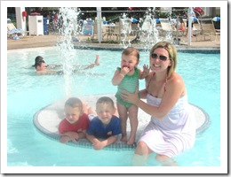 Florida vacation at condo Trish and kids in the pool near fountain