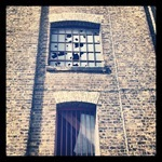 Smashed windows in Vinegar Street