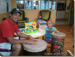 Playing on the bongos in the playroom.