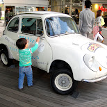 cute kid with a cute car in Odaiba, Tokyo, Japan