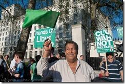Gaddafi supporter at stop the war demonstration