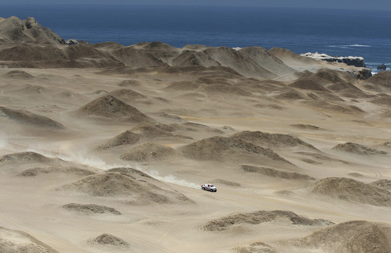 Toyota's driver Giniel De Villiers from South Africa and co-driver Dirk Von Zitzewitz from Germany, compete in the 12th stage of the 2012 Argentina-Chile-Peru Dakar Rally between Arequipa and Nazca, Peru, Friday Jan. 13, 2012. (AP Photo/Martin Mejia)