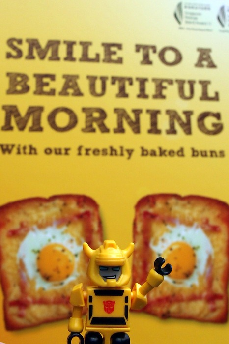 Bumblebee in front of Bread Talk poster - Smile to a Beautiful Morning