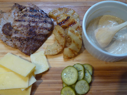 Sandwich ingredients-pork cutlet, pineapple, chile-lime-mayo, aged Cheddar and bread-and-butter pickles.