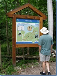 7206 Restoule Provincial Park - walk back to campsite - Bill studying Fire Tower Trail map