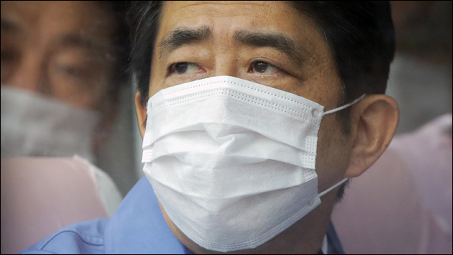 Japan's Prime Minister Shinzo Abe visits one of the Tokyo Electric Power Co. (Tepco) facilities at the crippled Fukushima nuclear power plant, 29 December 2012. Photo: Itsuo Inouye / AP