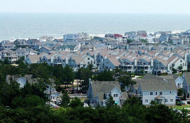 Rows of houses near the Currituck Beach Lighthouse, along the Atlantic coast in Corolla, on the Outer Banks of North Carolina. With virtually no debate, the state Senate nixed global warming restrictions on the state's coast, 12 June 2012. newsobserver.com