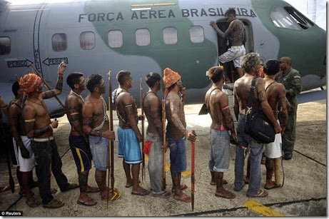 Munduruku Indians, many of whom are flying for the first time, board a Brazilian Air Force plane to fly to Brasilia, Brazil, for talks with the government, in Altamira, June 4 - Copy